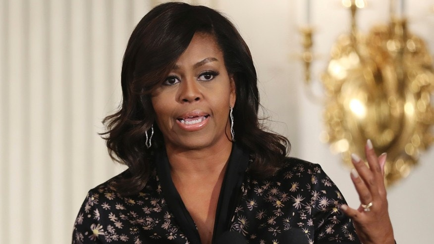 Official gets job back after racist post about Michelle Obama