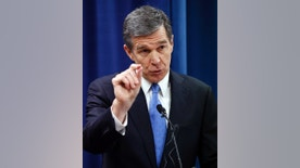 North Carolina's Governor-elect Roy Cooper holds a press conference to criticize efforts by Republicans to cut the power of the governor's office during the special session of the General Assembly that is going on a few blocks away on Thursday, Dec. 15, 2016, in Raleigh, N.C. (Chris Seward/The News & Observer via AP)
