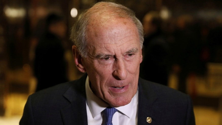 Former Sen. Dan Coats (R-IN) stops to speak to the news media after a meeting at Trump Tower with U.S. President-elect Donald Trump in New York, U.S., November 30, 2016.