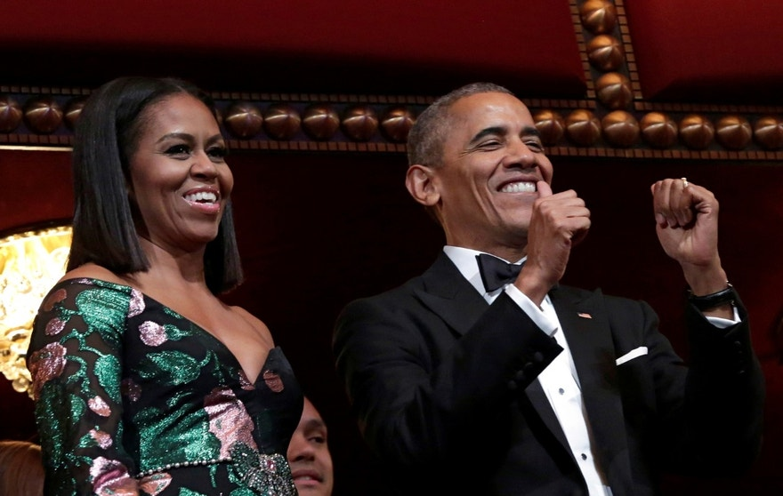 U.S. President Barack Obama gestures as he and first lady Michelle Obama attend the Kennedy Center Honors in Washington, U.S., December 4, 2016. REUTERS/Yuri Gripas - RTSUNEI