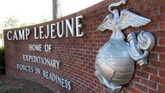 FILE - In this March 19, 2013 file photo, the globe and anchor stand at the entrance to Camp Lejeune, N.C. The Obama administration has agreed to provide disability benefits totaling more than $2 billion to veterans who had been exposed to contaminated drinking water while assigned to Camp Lejeune in North Carolina.  (AP Photo/Allen Breed, File)