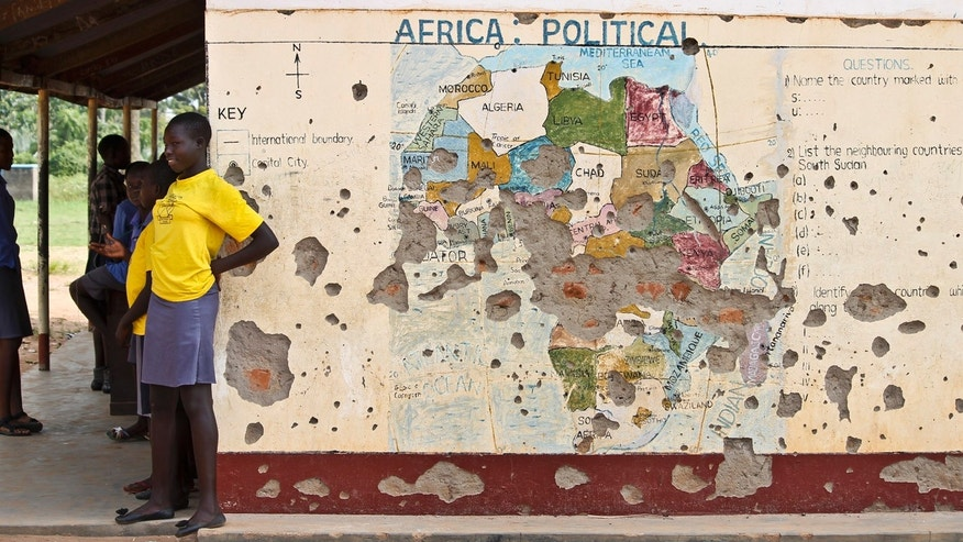 Nov. 15, 2016: Students line up outside a classroom with a map of Africa on its wall, in Yei, in southern South Sudan.
