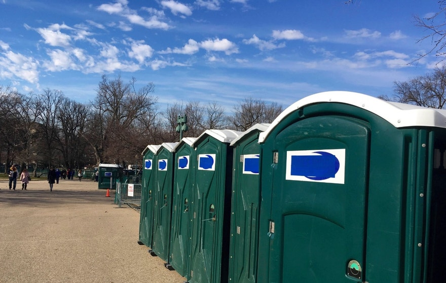 """A row of portable restrooms, with the name """"Don's Johns"""" covered up, is seen on Capitol Hill in Washington, Friday, Jan. 13, 2017. Virginia-based Don's Johns calls itself the Washington area's top provider of portable toilet rentals, but the name apparently strikes too close to home for inaugural organizers. Workers have placed blue tape over the brand name on dozens of portable restrooms installed near the Capitol for the inauguration. (AP Photo/Matthew Daly)"""