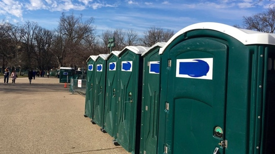 'Don's Johns' label taped over on Trump inauguration portable toilets