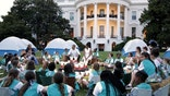 U.S. President Barack Obama (back C) and first lady Michelle Obama join Girl Scouts for a singalong during a camp-out on the South Lawn of the White House in Washington June 30, 2015. A group of 50 fourth-grade Girl Scouts plans to spend the night in camping tents on the lawn, a celebration of the scouting movement and the National Park Service centennial.  REUTERS/Jonathan Ernst - RTX1IIS1