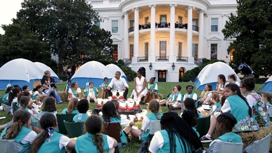 Girl Scouts at a White House event in 2015 with President Barack Obama and First Lady Michelle Obama. The Girl Scouts are coming under fire by some critics for plans to participate in the inauguration on January 20 of Donald Trump.