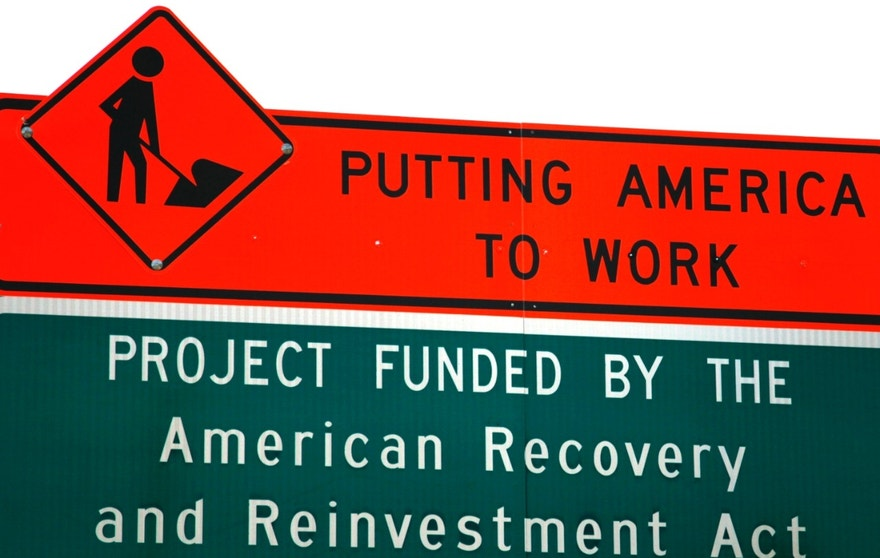 A sign announces a section of road work funded by the American Recovery and Reinvestment Act U.S. economic stimulus plan in the Denver area September 10, 2009. The White House Council of Economic Advisers said that the $787 billion stimulus package enacted earlier this year had created as many as 1.1 million jobs by the third quarter.  REUTERS/Rick Wilking (UNITED STATES BUSINESS SOCIETY) - RTR27ODU