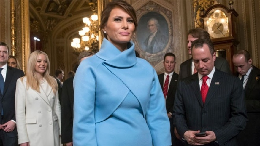 Melania Trump wore a sky-blue cashmere jacket and mock turtleneck dress by Ralph Lauren