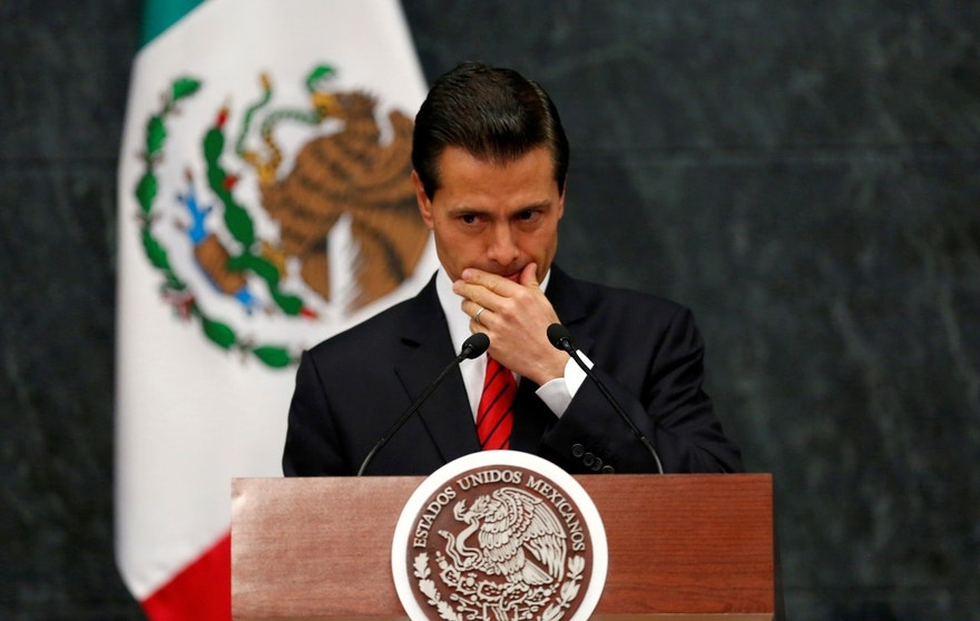 Mexico's President Enrique Pena Nieto gestures as he delivers a message after U.S. Republican candidate Donald Trump won an unexpected victory in the presidential election, at Los Pinos presidential residence in Mexico City, Mexico, November 9, 2016. REUTERS/Carlos Jasso - RTX2SWOE