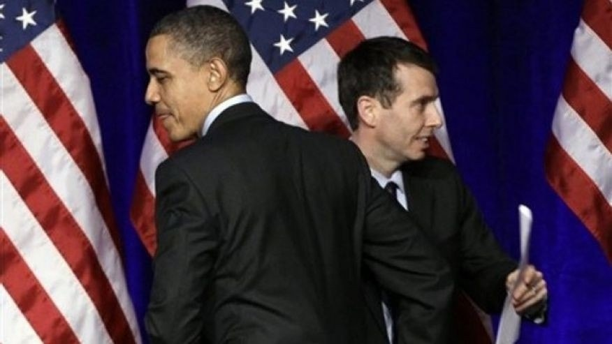 President Obama is introduced by senior adviser David Plouffe before he speaks at a Democratic National Committee event in Washington March 16, 2011.