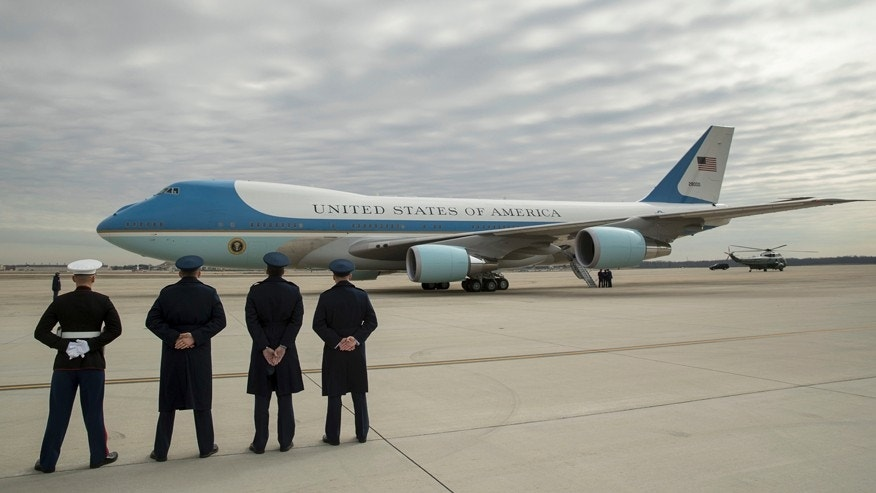 Feb. 17, 2017: Military personnel watch as Air Force One, with President Donald Trump, aboard prepares to depart at Andrews Air Force Base in Md. Trump is visiting Boeing South Carolina to see the Boeing 787 Dreamliner before heading to his estate Mar-a-Lago in Palm Beach, Fla., for the weekend.