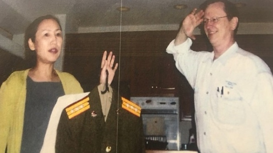 Undated photo: UMT academic dean J. Davidson Frame, right, salutes his wife, left, UMT president Yanping Chen Frame.