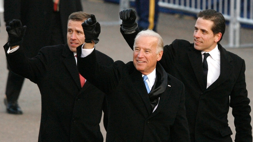 U.S. Vice President Joe Biden walks with his sons Beau (L) and Hunter (2nd R) own Pennsylvania Avenue during the inaugural parade in Washington January 20, 2009.