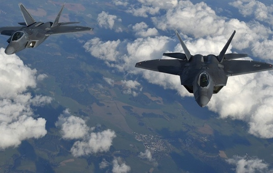 Two U.S. F-22 Raptor fighters fly over European airspace during a flight to Britain from Mihail Kogalniceanu air base in Romania April 25, 2016. REUTERS/Toby Melville - RTX2BM2B