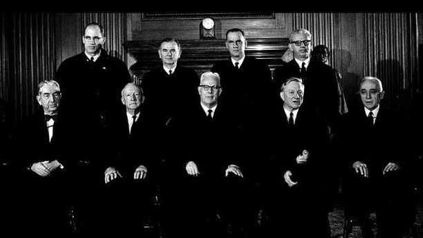 Chief Justice Earl Warren and the eight Associate Justices of the Supreme Court are shown on Nov. 19, 1962 in Washington. From left, seated: Associate Justices Tom C. Clark and Hugo L. Black ; Chief Justice Earl Warren ; Associate Justices William O. Douglas and John M. Harlan. From left, Standing: Associate Justices Byron R. White, William J. Brennan, Jr., Potter Stewart and Athur J. Goldberg.  (AP Photo)