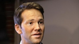 FILE - In this Feb. 6, 2015 file photo, former  U.S. Rep. Aaron Schock speaks to reporters in Peoria, Ill. Howard Foster, who donated $500 to the former congressman's campaign is suing Schock in U.S. District Court in Chicago seeking repayment of all contributions to Schock's campaign. Daniel Kurowski an attorney for Foster told a federal judge during a hearing Wednesday April, 29, 2015, in Chicago, he can't locate the Republican who resigned in March amid questions about his spending. Kurowski said he hasn't been able to inform Schock about the lawsuit. Kurowski tried a Peoria address for Schock, but the property is now vacant. (AP Photo/Seth Perlman, File)