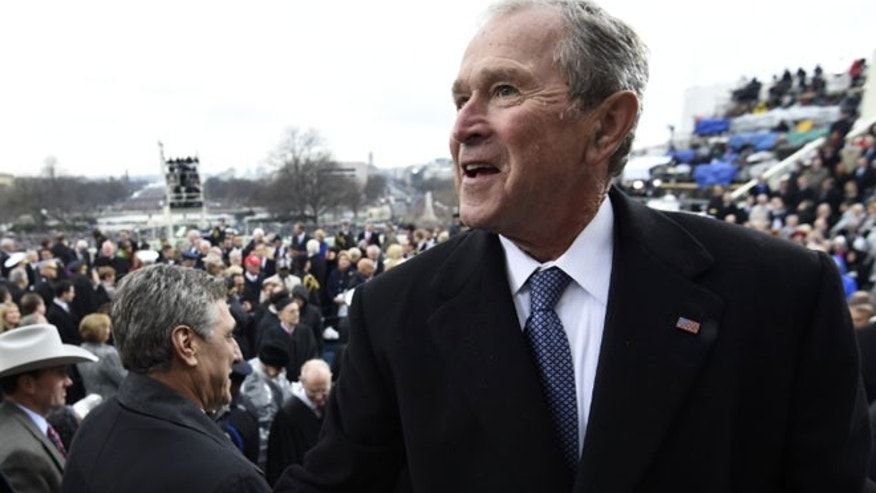 Former US president George W. Bush leaves after the Presidential Inauguration at the US Capitol in Washington