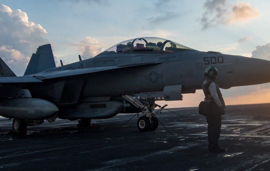 """170408-N-HD638-126 SOUTH CHINA SEA (April 8, 2017) Sailors assigned to the Electronic Attack Squadron (VAQ) 136 """"Gauntlets"""" prepare an EA-18G Growler for flight on the aircraft carrier USS Carl Vinson (CVN 70). The Carl Vinson Carrier Strike Group is on a regularly scheduled Western Pacific deployment as part of the U.S. Pacific Fleet-led initiative to extend the command and control functions of U.S. 3rd Fleet. U.S Navy aircraft carrier strike groups have patrolled the Indo-Asia-Pacific regularly and routinely for more than 70 years. (U.S. Navy photo by Mass Communication Specialist 3rd Class Matt Brown/Released)"""