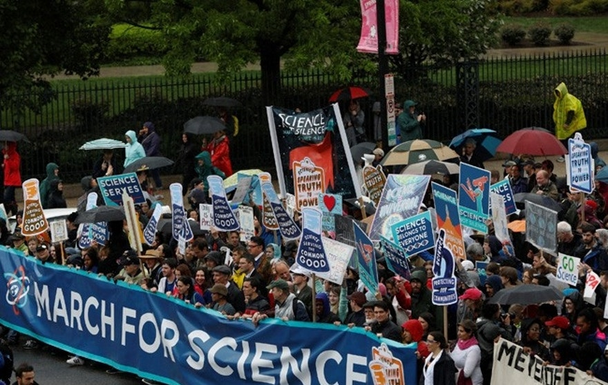 Demonstrators march to the U.S. Capitol during the March for Science in Washington, U.S., April 22, 2017. REUTERS/Aaron P. Bernstein - RTS13GY0