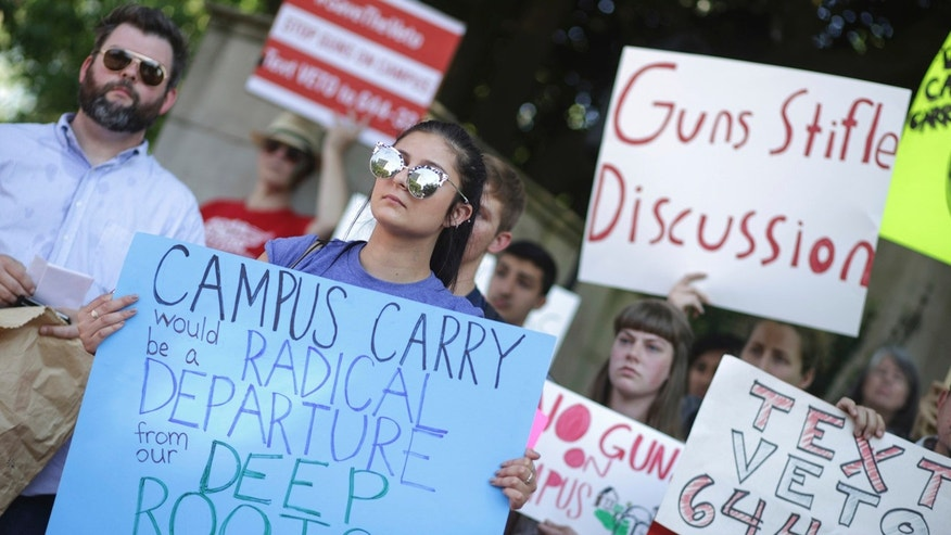 Gov. Nathan Deal signed legislation Thursday allowing people with permits to carry concealed handguns on Georgia's public college campuses, despite the objections of state university leaders and his own veto of a campus-carry measure last year.