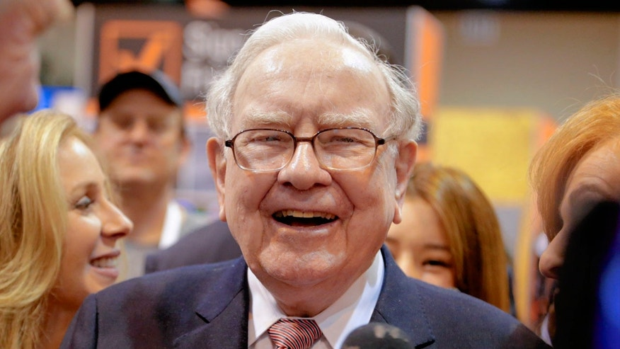 Berkshire Hathaway Chairman and CEO Warren Buffett laughs while touring the exhibit floor at the CenturyLink Center in Omaha, Neb., Saturday, May 6, 2017, where company subsidiaries display their products.
