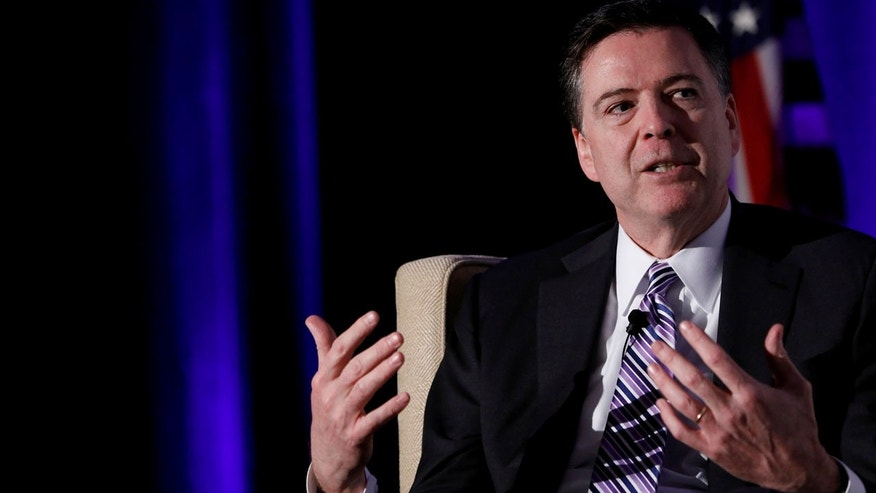 Former FBI Director James Comey speaks at the Intelligence National Security Alliance Leadership Dinner at the Hilton Mark Center in Alexandria, Virginia, U.S., March 29, 2017