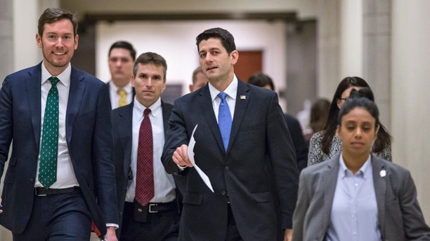 House Speaker Paul Ryan of Wis., center, walks with his chief communications adviser Brendan Buck, left, on the way to meet with reporters on Capitol Hill in Washington, Thursday, Feb. 4, 2016. Ryan announced the formation of six committee-led task forces charged with developing agendas on national security, tax reform, jobs, health care reform, elimination of poverty, and more. Ryan also pledged that House Republicans will schedule time this year to vote on legislation reforming the criminal justice system. (AP Photo/J. Scott Applewhite)