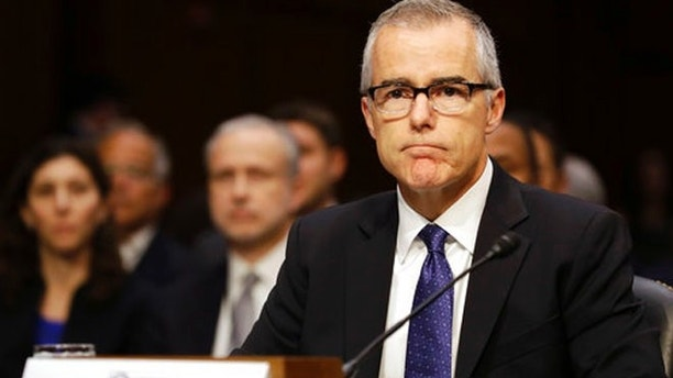 Acting FBI Director Andrew McCabe listens on Capitol Hill in Washington, Thursday, May 11, 2017, while testifying before a Senate Intelligence Committee hearing on major threats facing the U.S. (AP Photo/Jacquelyn Martin)