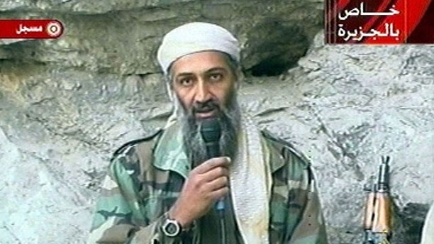 FILE - This image made from video broadcast on Sunday, Oct. 7, 2001 shows Osama bin Laden at an undisclosed location. Al-Qaida leader Osama bin Laden threatened in a new audio tape, posted on Al-Jazeera's website Wednesday, Oct. 27, 2010, to kill French citizens to avenge their country's support for the U.S.-led war in Afghanistan and a new law that will ban face-covering Muslim veils. The authenticity of the tape could not be immediately verified but the voice resembled that of the terrorist group leader on previous tapes determined to be genuine. (AP Photo/Al-Jazeera, File)
