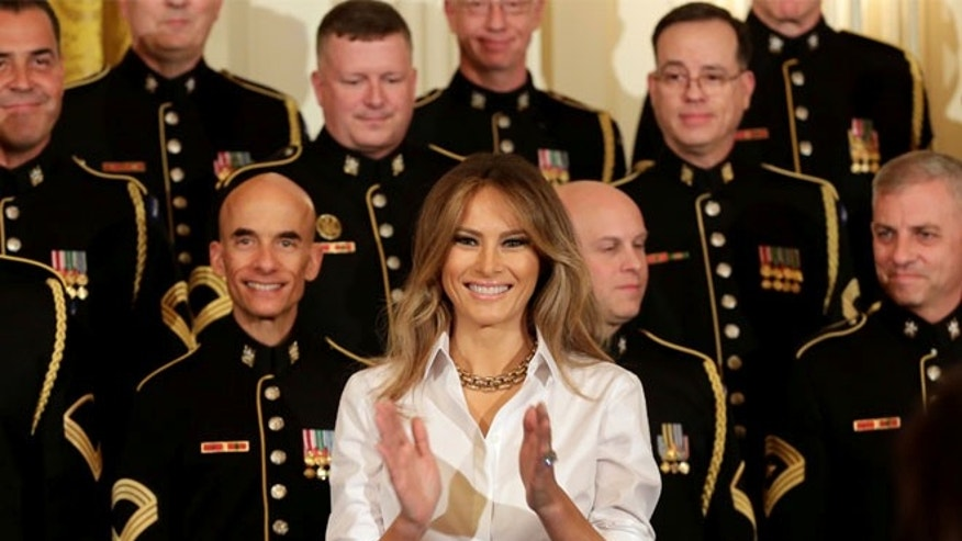 MAY 12: U.S. First lady Melania Trump applauds United States Army Chorus at the White House in Washington