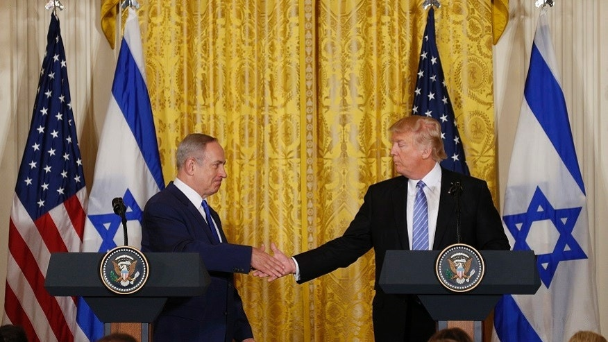 U.S. President Donald Trump greets Israeli Prime Minister Benjamin Netanyahu after a joint news conference at the White House. The two men are set to meet next week in Israel during Trump's first foreign trip as president.