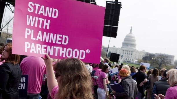 "FILE: In this April 7, 2011, photo, members of Planned Parenthood, NARAL Pro-Choice America and more than 20 other organizations hold a ""Stand Up for Women's Health"" rally in support of preventive health care and family planning services, including abortion, in Washington."