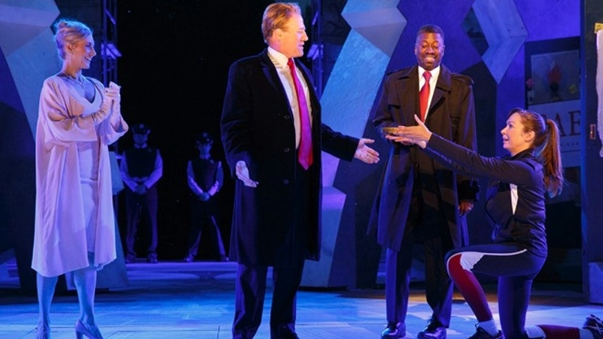 FILE: Tina Benko, left, portrays Melania Trump in the role of Caesar's wife, Calpurnia, and Gregg Henry, center left, portrays President Donald Trump in the role of Julius Caesar during a dress rehearsal of The Public Theater's Free Shakespeare in the Park production of Julius Caesar in New York.