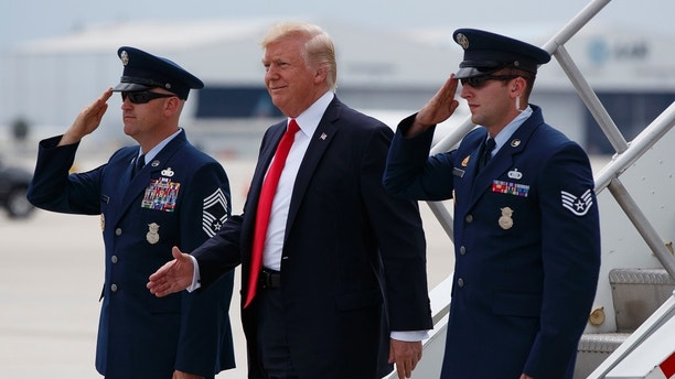 President Donald Trump smiles upon his arrival on Air Force One at Miami International Airport in Miami, Friday, June 16, 2017, before speaking on Cuba policy.  (AP Photo/Evan Vucci)