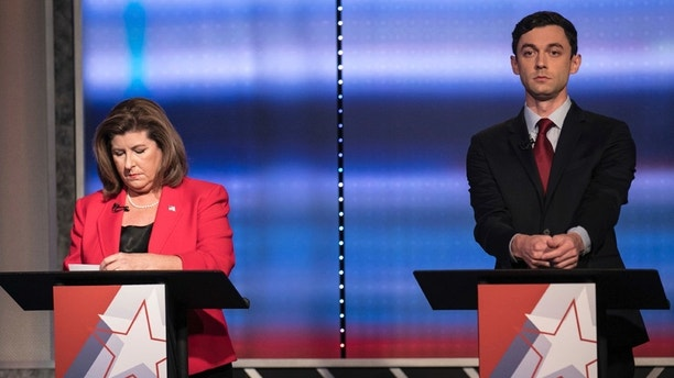 FILE - In this June 6, 2017 file photo, candidates in Georgia's 6th Congressional District race Republican Karen Handel, left, and Democrat Jon Ossoff prepare to debate in Atlanta.  Handel and  Ossoff are making their last push this weekend before voters in Georgia's 6th Congressional District cast ballots Tuesday, June 20,  to replace Tom Price in Washington, a contest seen as an early political test for the Trump administration.