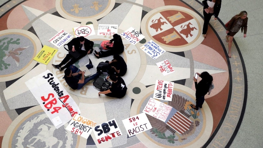 "In this April 26, 2017, file photo, students gather in the Rotunda at the Texas Capitol to oppose SB4, an anti-""sanctuary cities"" bill that seeks to jail sheriffs and other officials who refuse to help enforce federal immigration law."