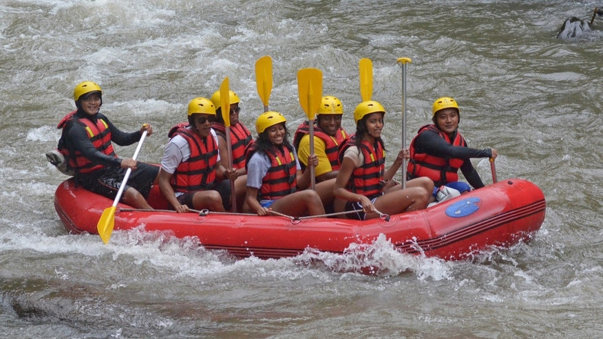 Former President Barack Obama (2nd L), his wife Michelle (3rd L) along with his daughters Sasha (C) and Malia (2nd R) go rafting while on holiday in Bongkasa Village, Badung Regency, Bali, Indonesia June 26, 2017 in this photo taken by Antara Foto.
