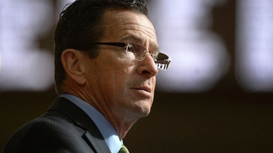 FILE- In this Feb. 8, 2017, file photo, Connecticut Gov. Dannel P. Malloy delivers his budget address to members of the house and senate inside the Hall of the House at the state Capitol in Hartford, Conn. Malloy made a last-ditch attempt Wednesday, June 28, to persuade leaders of the state House of Representatives to pass the three-month mini budget he crafted and avoid what will be deep cuts to everything from youth summer jobs and rental assistance programs. (AP Photo/Jessica Hill, File)