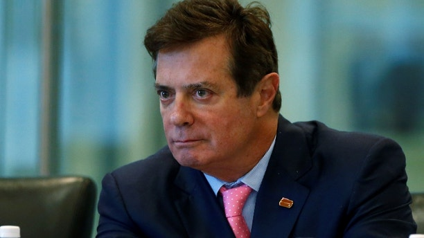 Paul Manafort of Republican presidential nominee Donald Trump's staff listens during a round table discussion on security at Trump Tower in the Manhattan borough of New York, U.S., August 17, 2016. Picture taken August 17, 2016.  REUTERS/Carlo Allegri - RTX2M246