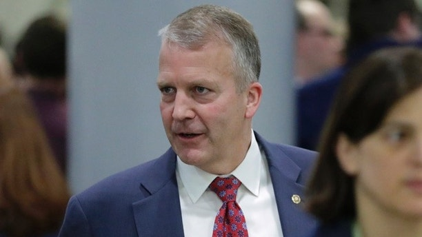 Sen. Dan Sullivan, R-Alaska, leaves the Capitol after Republicans released their long-awaited bill to scuttle much of President Barack Obama's Affordable Care Act, in Washington, Thursday, June 22, 2017. GOP leaders hope to vote on the bill next week and can only afford two defections from the 52 Senate Republicans but the measure encountered immediate trouble as four Republican senators said they opposed it but were open to negotiations. (AP Photo/J. Scott Applewhite)