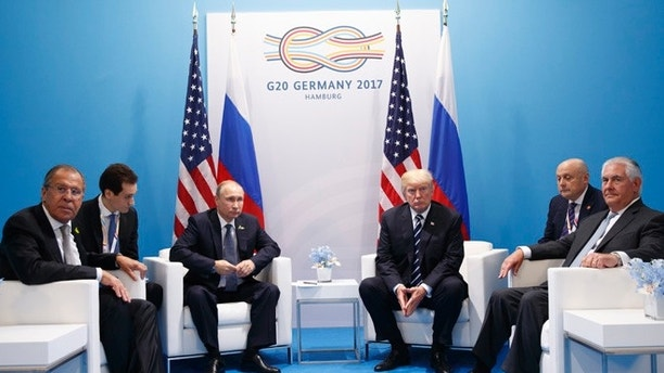 President Donald Trump meets with Russian President Vladimir Putin at the G20 Summit, Friday, July 7, 2017, in Hamburg. Russian Foreign Minister Sergey Lavrov is at left, Secretary of State Rex Tillerson is at right. (AP Photo/Evan Vucci)