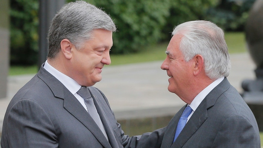 Ukrainian President Petro Poroshenko, left, and U.S. Secretary of State Rex Tillerson shakes hands before a meeting in Kiev, Sunday, July 9, 2017.