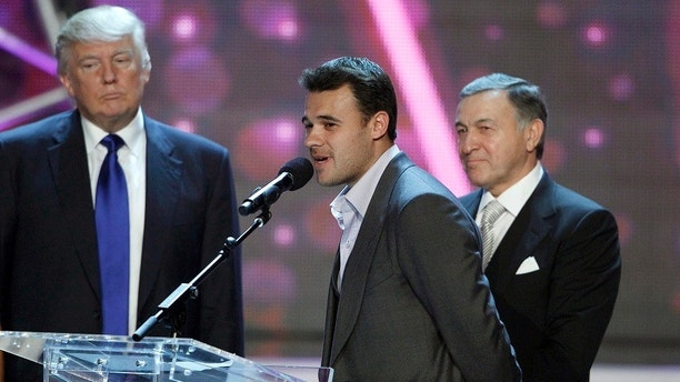 Russian singer Emin Agalarov (C) speaks as his father Aras Agalarov and Donald Trump (L), co-owner of the Miss Universe Organization, look on during a news conference after the 2013 Miss USA pageant at the Planet Hollywood Resort and Casino in Las Vegas, Nevada June 16, 2013. Trump announced that the 2013 Miss Universe pageant will be held November 9 at the Crocus City Hall in Moscow. REUTERS/Steve Marcus (UNITED STATES - Tags: ENTERTAINMENT BUSINESS) FOR EDITORIAL USE ONLY. NOT FOR SALE FOR MARKETING OR ADVERTISING CAMPAIGNS - RTX10QHN