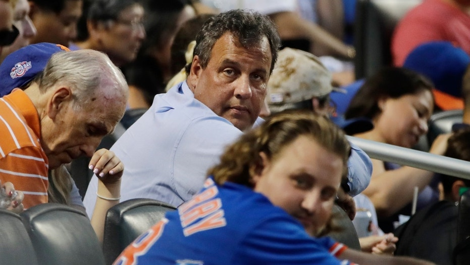 New Jersey Gov. Chris Christie watches during the fourth inning of a baseball game between the New York Mets and the St. Louis Cardinals on Tuesday, July 18, 2017, in New York.
