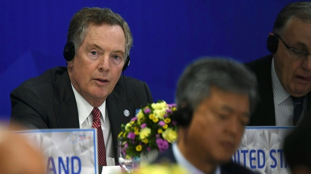 US Trade Representative Robert Lighthizer listens while attending a joint press conference held on the sideline of the APEC Ministers Responsible For Trade (APEC MRT 23) meeting in Hanoi, Vietnam, May 21, 2017. REUTERS/Hoang Dinh Nam/Pool - RTX36SKN