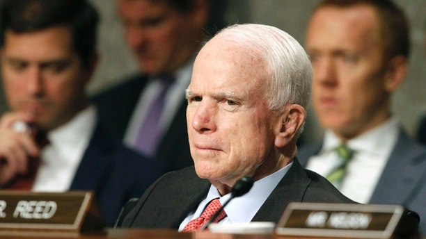 """FILE - In this July 11, 2017 file photo, Senate Armed Services Committee Chairman Sen. John McCain, R-Ariz. listens on Capitol Hill in Washington, during the committee's confirmation hearing for Nay Secretary nominee Richard Spencer. Surgeons in Phoenix said they removed a blood clot from above the left eye of McCain. Mayo Clinic Hospital doctors said Saturday, July 15 that McCain underwent a """"minimally invasive"""" procedure to remove the nearly 2-inch (5-centimeter) clot, and that the surgery went """"very well."""" They said the 80-year-old Republican is resting comfortably at his home in Arizona. Pathology reports are expected in the next several days.  (AP Photo/Jacquelyn Martin, File)"""