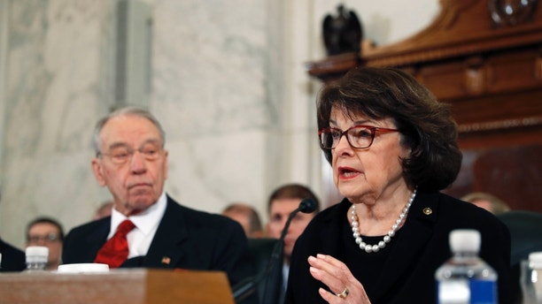 Senate Judiciary Committee Chairman Sen. Charles Grassley, R-Iowa listens at left, as the committees ranking member, Sen. Dianne Feinstein, D-Calif. questions Attorney General-designate, Sen. Jeff Sessions, R-Ala. during Sessions confirmation hearing before the copmmittee, Tuesday, Jan. 10, 2017, on Capitol Hill in Washington.  (AP Photo/Alex Brandon)