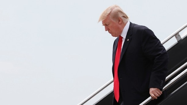 \President Donald Trump arrives on Air Force One at Dulles International Airport in Dulles, Va., Saturday, July 22, 2017, after attending the commissioning ceremony of the aircraft carrier USS Gerald R. Ford (CVN 78) at Naval Station Norfolk, Va. (AP Photo/Carolyn Kaster)\