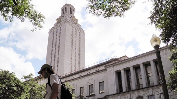 A student walks at the University of Texas campus in Austin, Texas, U.S. on June 23, 2016. The U.S. Supreme Court on Thursday, upheld the practice of considering race in college admissions, rejecting a white woman's challenge to a University of Texas affirmative action program designed to boost the enrollment of minority students. REUTERS/Jon Herskovitz/File Photo - RTSKYAX