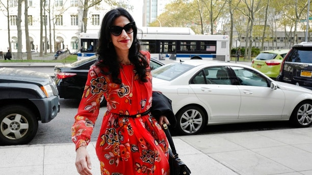 "FILE - In this Nov. 2, 2016 file photo, Huma Abedin is seen in the Brooklyn borough of New York. A person familiar with the investigation into Hillary Clinton's use of a private email server says Abedin did not forward ""hundreds and thousands"" of emails to her husband's laptop, as FBI Director James Comey testified to Congress. (AP Photo/Mark Lennihan, File)"